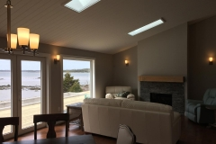 Living room lighting wired and installed with a beautiful Nova Scotia ocean view.